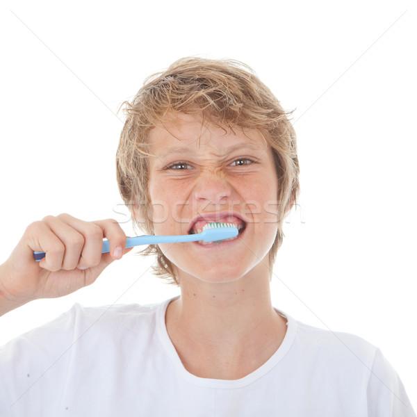 Gyermek fogmosás fogkefe fogkrém gyerekek tini Stock fotó © godfer