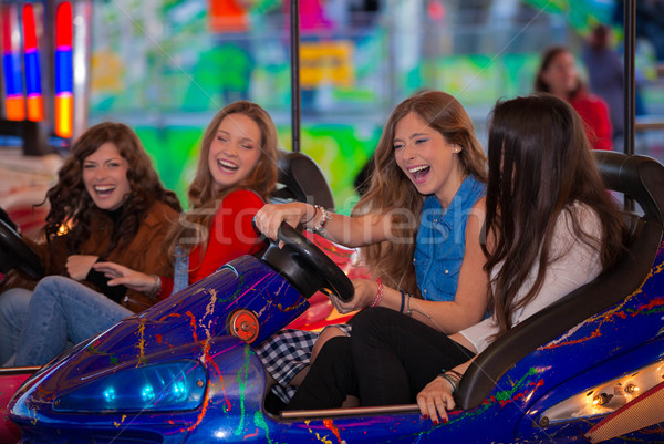 Stock photo: carnival bumper ride group of teens