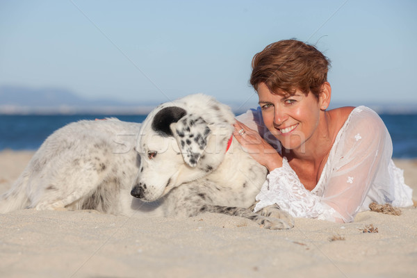 Zdjęcia stock: Kobieta · wakacje · domowych · psa · plaży