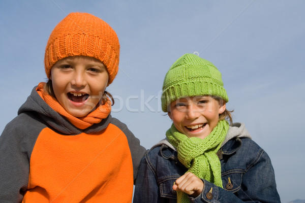 happy smiling, winter kids, in hats and scarves Stock photo © godfer