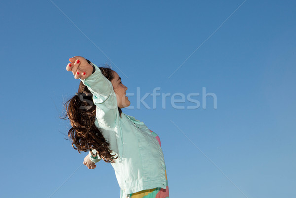 kid raising arms for freedom holiday concept Stock photo © godfer