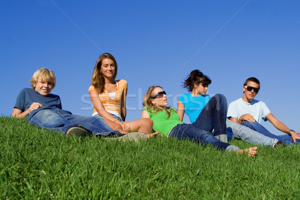 group of teens students relaxing on campus Stock photo © godfer
