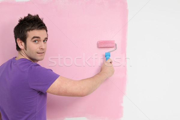 young man painting decorating with roller brush Stock photo © godfer