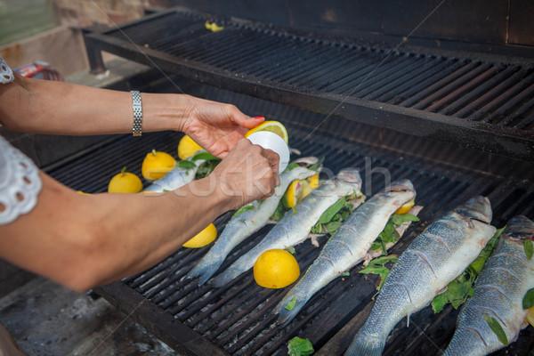 preparing fish meal outdoors Stock photo © godfer