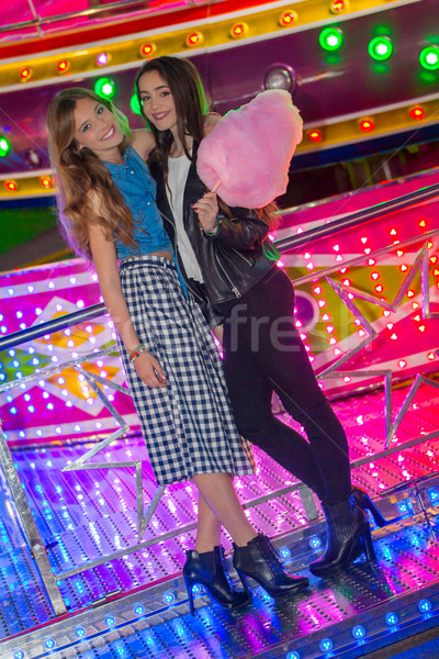 girls at the fair with candy floss Stock photo © godfer