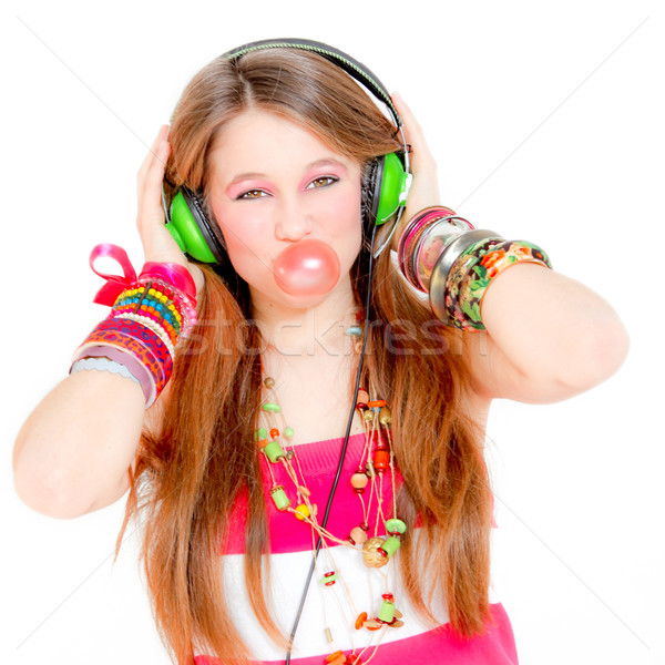 Stock photo: funky girl listening to music and blowing bubble with gum