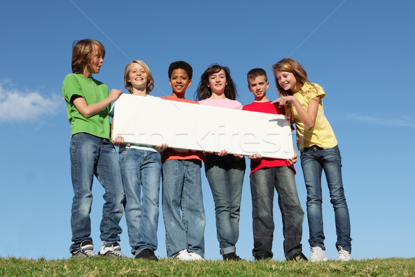 diverse group of summer camp kids with sign Stock photo © godfer