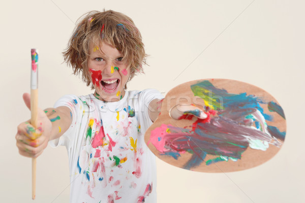 boy painting with brush and pallete Stock photo © godfer