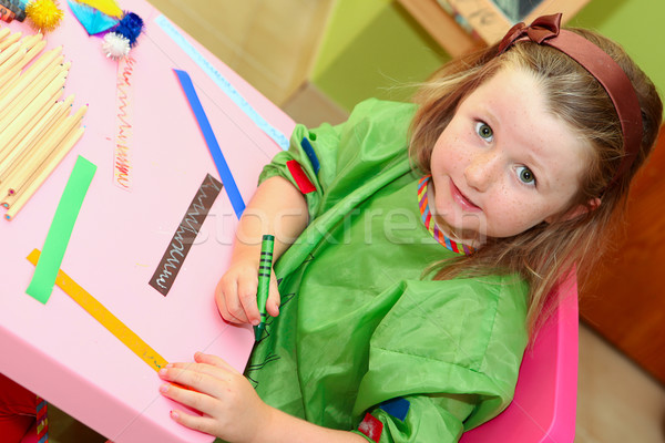 happy kid drawing at home or school kindergarden or kindergarten Stock photo © godfer