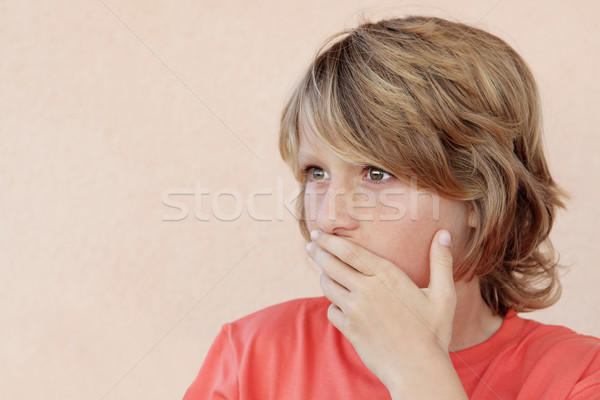 shocked child hand up to mouth in shock Stock photo © godfer