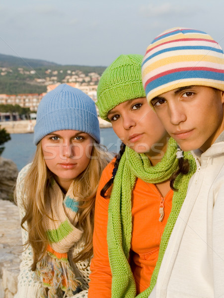 group of trendy fashion teens in knitwear, knitted hats and scarfs Stock photo © godfer