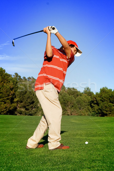 young man swinging golf club Stock photo © godfer