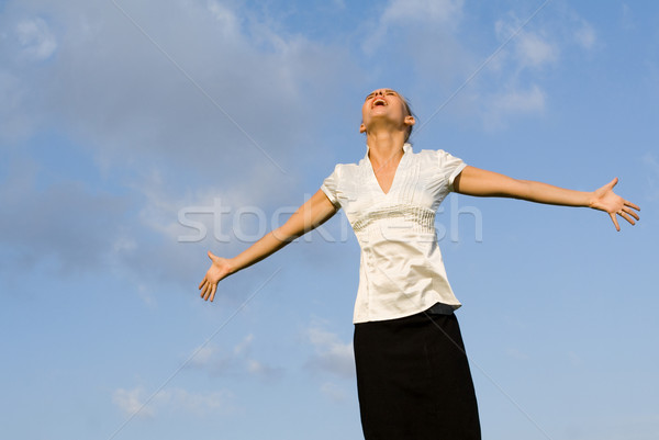 happy woman singing outdoors, looking up arms outstretched Stock photo © godfer