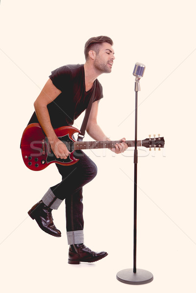 Chanter guitare micro hommes Rock Photo stock © godfer