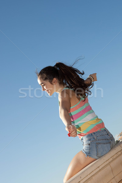 teen arms outstretched for vacation freedom Stock photo © godfer