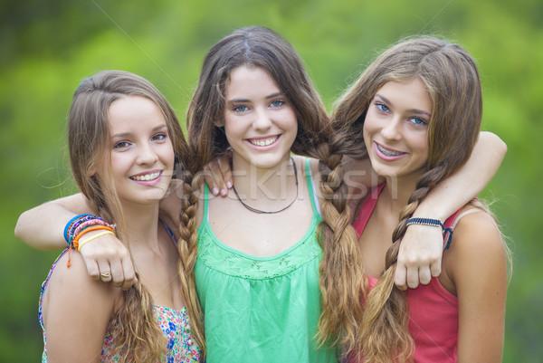 happy smiling teenage girls with white teeth Stock photo © godfer
