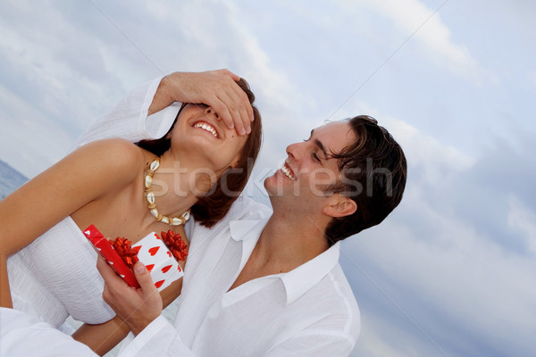 loving couple giving birthday, engagement or wedding gifts. Stock photo © godfer