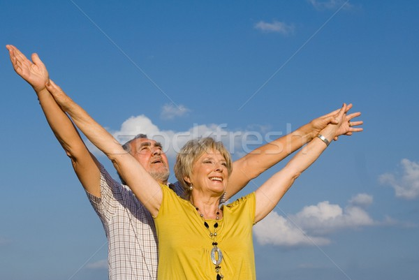 healthy active christian senior couple arms raised in praise Stock photo © godfer