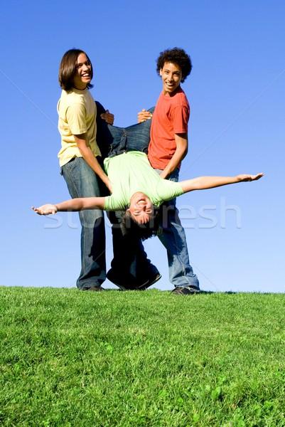 Sokoldalú csoport tini fiúk jókedv tinédzserek Stock fotó © godfer