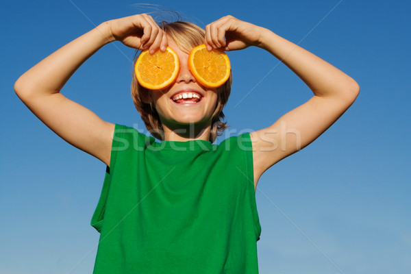 Feliz sorridente criança fruto dieta saudável Foto stock © godfer