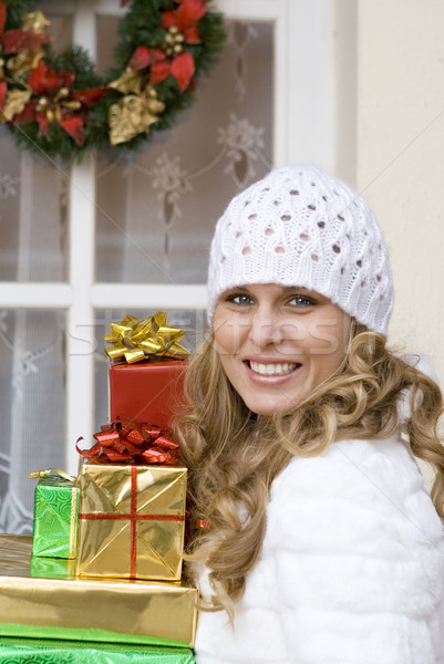 woman arriving at christmas party laden with gifts. Stock photo © godfer