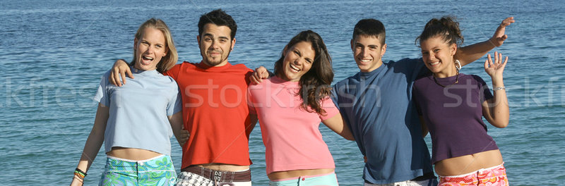 friendship group of teens, youth, kids or students at the beach,  Stock photo © godfer