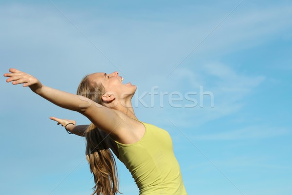young happy woman singing song or shouting praise Stock photo © godfer