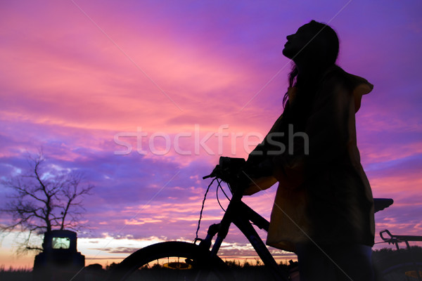 Girl at sunset Stock photo © goinyk