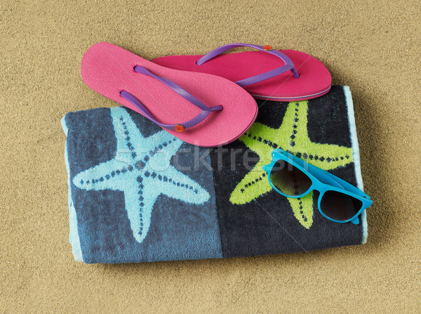 Slippers, sun glasses and towel Stock photo © goir