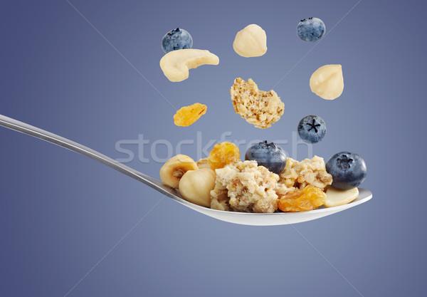 Céréales déjeuner cuillère banane mouvement repas Photo stock © goir