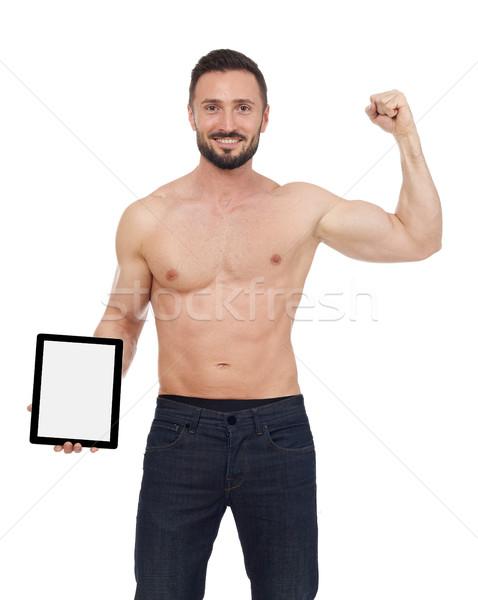 Muscular man with digital tablet Stock photo © goir