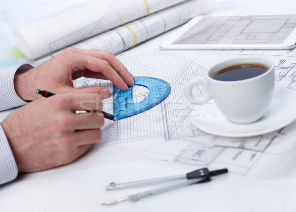 Reviewing a blueprint on table Stock photo © goir