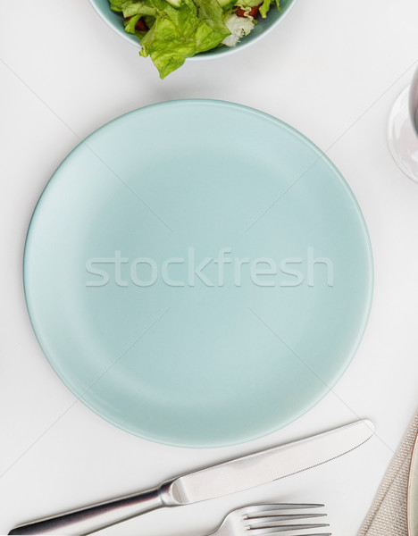 Empty plate on a dining table Stock photo © goir