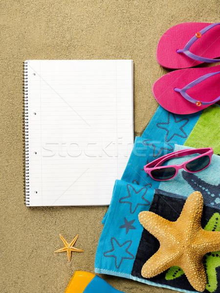 Praia cena livro caderno areia natação Foto stock © goir
