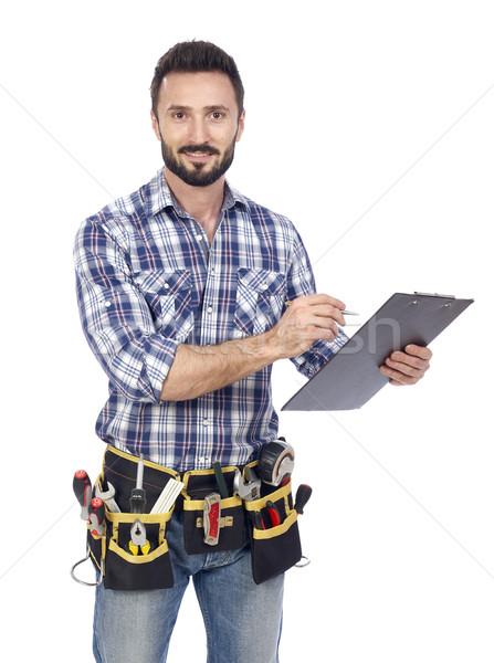 Handyman taking notice Stock photo © goir