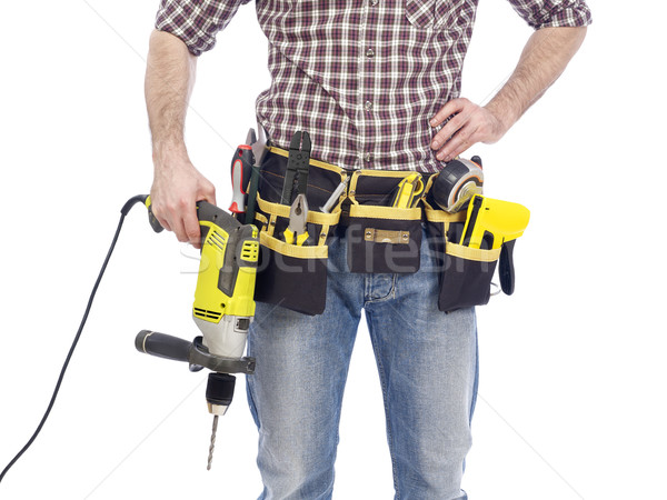 Carpenter with tool belt and drill Stock photo © goir