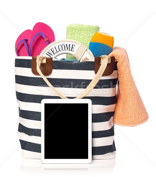 Beach bag and tablet Stock photo © goir