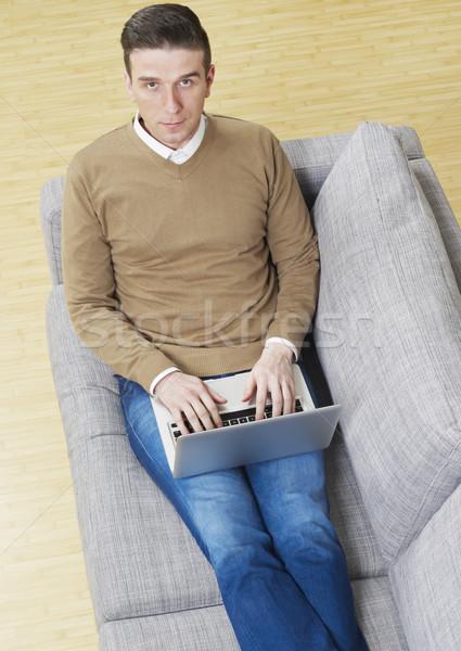 человека диване ноутбука рабочих интернет технологий Сток-фото © goir