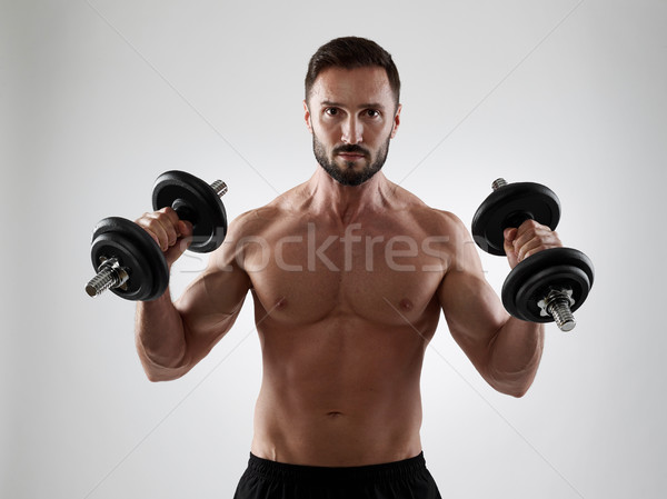 Poids musculaire homme isolé Photo stock © goir