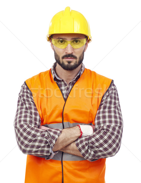 Carpenter with hardhat and protective glasses Stock photo © goir