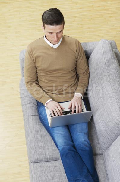 Szörfözik internet otthon férfi kanapé dolgozik Stock fotó © goir