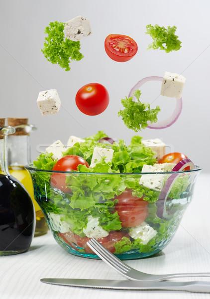 Salátástál zuhan zöldségek étel levél vacsora Stock fotó © goir