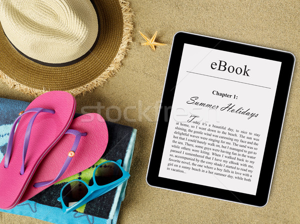 eBook tablet on beach Stock photo © goir
