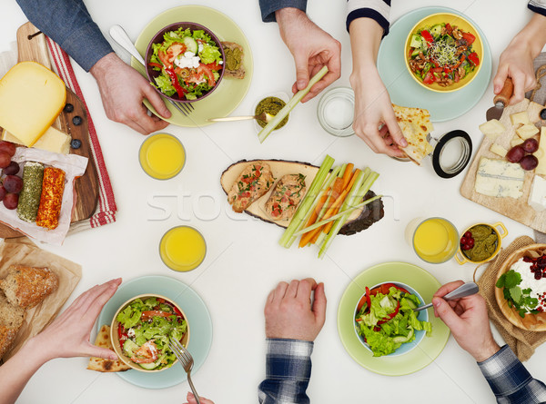 View from above of friends having dinner Stock photo © goir