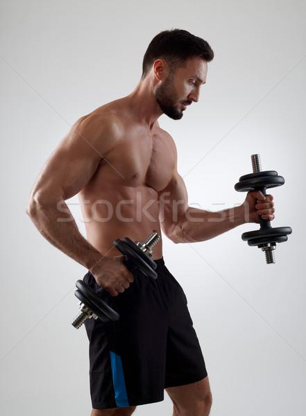 Ağırlıklar kas adam yalıtılmış Stok fotoğraf © goir