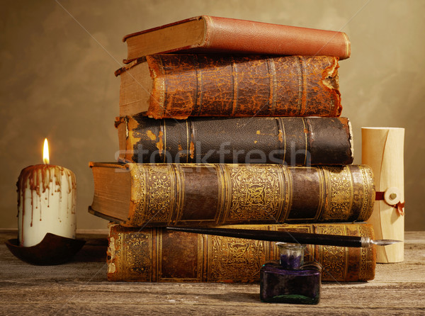 Ink pot, quill, candle and antique books Stock photo © goir
