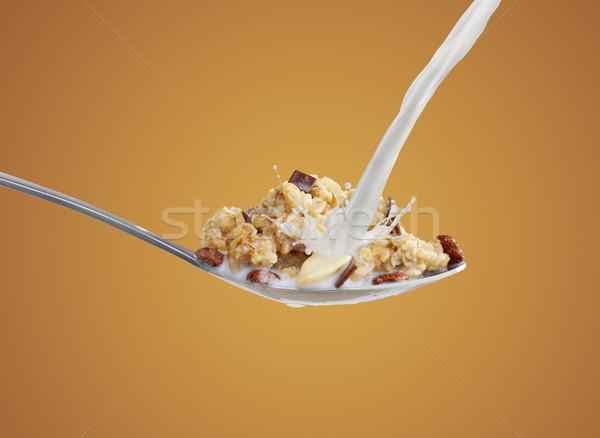 Cereais matinais colher leite banana movimento Foto stock © goir
