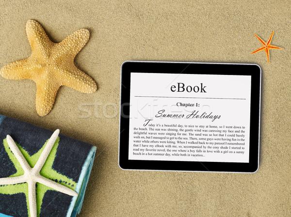 eBook tablet on beach Stock photo © goir