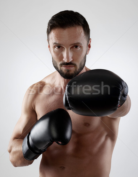 Musculaire boxeur gants de boxe sport gymnase boxe Photo stock © goir