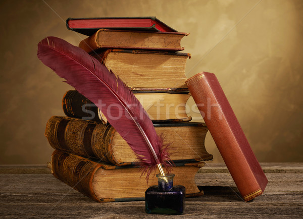 Ink pot, quill and antique books Stock photo © goir